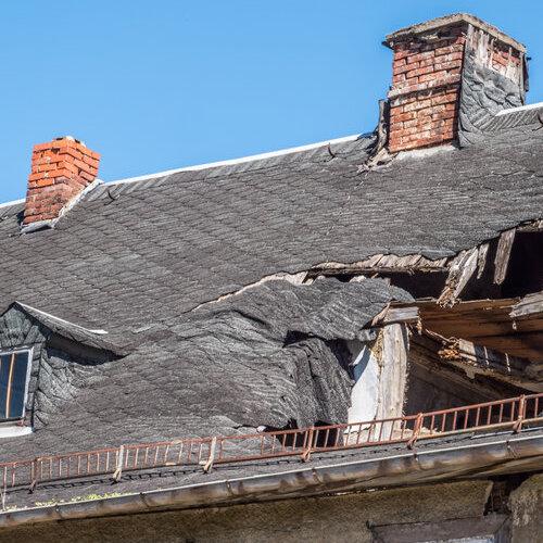 Shingle roof with major storm damage.