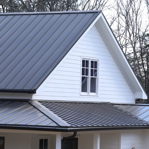 Home with a dark gray metal roof.