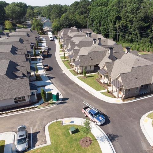 View from above of several homes with shingle roofs.