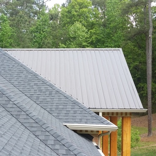 Roofs with shingles and seamed metal roofing.